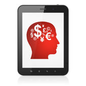 Education concept: Head With Finance Symbol on tablet pc compute — Stock Photo
