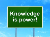 Education concept: Knowledge Is power! on road sign background — Stock Photo