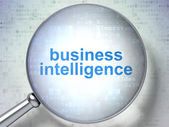 Finance concept: Business Intelligence with optical glass — Stock Photo