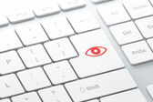 Privacy concept: Eye on computer keyboard background — Stock Photo