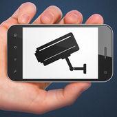 Privacy concept: Cctv Camera on smartphone — Stok fotoğraf