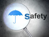 Safety concept: Umbrella and Safety with optical glass — Stock Photo