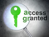 Protection concept: Key and Access Granted with optical glass — Stock Photo