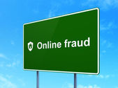 Protection concept: Online Fraud and Shield on road sign — Stock Photo
