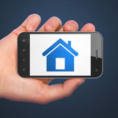 Finance concept: Home on smartphone — Foto de Stock