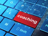 Education concept: Coaching on computer keyboard background — Stock Photo