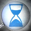 Time concept: Hourglass with optical glass on digital — Stock Photo