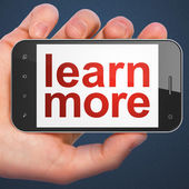 Education concept: Learn More on smartphone — Stock Photo