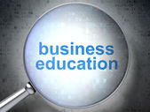 Education concept: Business Education with optical glass — Stock Photo