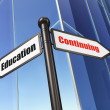 Stock Photo: Education concept: Continuing Education on Building background
