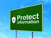 Security concept: Protect Information and Shield With Keyhole on road sign background — Stock Photo