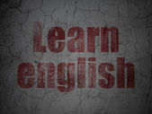 Education concept: Learn English on grunge wall background — Foto Stock