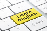 Education concept: Learn English on computer keyboard background — Stock Photo