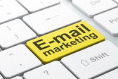 Marketing concept: E-mail Marketing on computer keyboard background — Stock Photo