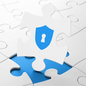 Security concept: Shield With Keyhole on puzzle background — Stock Photo