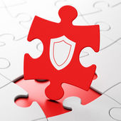 Protection concept: Shield on puzzle background — Stock Photo