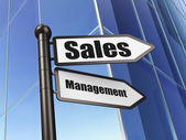 Marketing concept: Sales Management on Building background — 图库照片