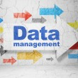 Data concept: arrow whis Data Management on grunge wall background — Stock Photo