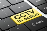 Protection concept: CCTV In action on computer keyboard — Stock Photo