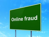 Privacy concept: Online Fraud on road sign background — Stock Photo