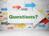 Education concept: arrow whis Questions? on grunge wall background — Stock Photo
