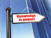 Education concept: Knowledge Is power! on Building background — Stockfoto