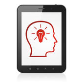 Education concept: Head With Lightbulb on tablet pc computer — 图库照片