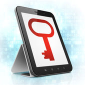 Protection concept: Key on tablet pc computer — Stockfoto