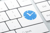 Time concept: Clock on computer keyboard background — Stockfoto