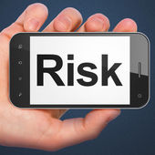 Finance concept: Risk on smartphone — Stock Photo