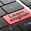 Foto Stock: Education concept: Learn English on computer keyboard background