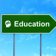 Education concept: Education and Head With Gears on road sign background — Foto Stock