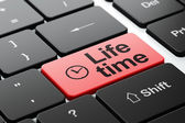 Time concept: Clock and Life Time on computer keyboard background — Stock Photo