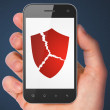 Stock Photo: Security concept: Broken Shield on smartphone