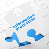 Concepto de privacidad: protección de la información sobre fondo de rompecabezas — Foto de Stock