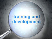 Education concept: Training and Development with optical glass — Stock Photo