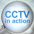 Stock Photo: Privacy concept: CCTV In action with optical glass