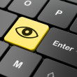 Stock Photo: Safety concept: Eye on computer keyboard background