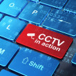 Safety concept: Cctv Camera and CCTV In action on computer keyboard background — Stock Photo