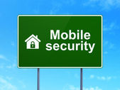 Protection concept: Mobile Security and Home on road sign background — Foto de Stock