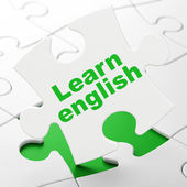 Education concept: Learn English on puzzle background — Stok fotoğraf