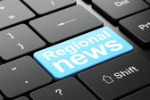 News concept: Regional News on computer keyboard background — Stockfoto
