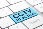 Privacy concept: CCTV In action on computer keyboard background — Stockfoto