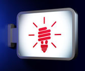 Business concept: Energy Saving Lamp on billboard background — Stock Photo