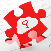 Cloud technology concept: Cloud With Key on puzzle background — 图库照片