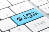 Education concept: Head With Gears and Learn English on computer keyboard background — Foto de Stock