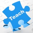 Education concept: Teach on puzzle background — Foto de Stock