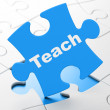 Education concept: Teach on puzzle background — Lizenzfreies Foto
