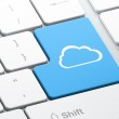 Cloud networking concept: Cloud on computer keyboard background — Stock Photo #35169611