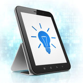 Finance concept: Light Bulb on tablet pc computer — Stock Photo